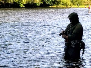 This salmon fisher was calm as he waited for the Chinook salmon to tire.