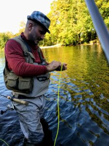 A Yugoslavian angler helps me prepare my line and bait on day three of my Salmon River trip.