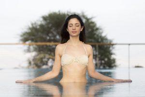 A girl enjoys the Dead Sea mud.