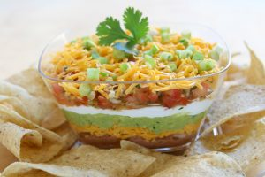 7-Layer Dip is a favorite at parties. Homemade taste enhances the flavor of the dip with a homemade twist.