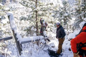 Slacklining crew hangs out in the snow